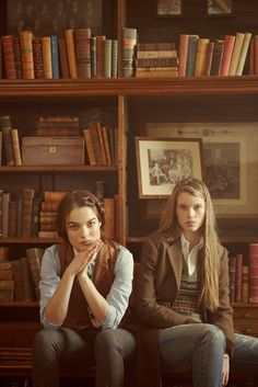 Girls in library wearing tweed, oxford cloth, and Fair Isle knits.  Fair Isle is a traditional knitting technique used to create patterns with multiple colours. It is named after Fair Isle, a tiny island in the north of Scotland, that forms part of the Shetland islands. Fair Isle knitting gained a considerable popularity when the Prince of Wales (later to become Edward VIII) wore Fair Isle tank tops in public in 1921.