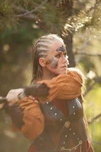 Celtic woman warrior preparing for battle