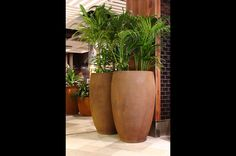 Our Rusted Tall Egg makes for a beautiful statement piece in the new Westfield Shopping Centre. Westfield Shopping Centre, Shopping Center, Westfield Miranda, New Market, Paint Finishes, Planter Pots, Egg, How To Make, Beautiful