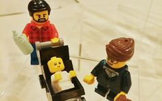 The figurines of the Lego stay-at-home dad, with baby and working mum.