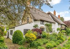 Beautiful scenery: The 18th century cottage has been completely renovated in recent years, including a re-thatch in 2017