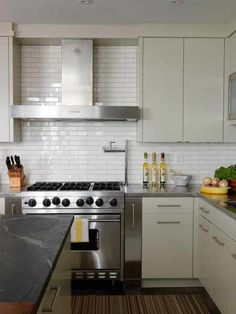 Dream Cooks Kitchen-2x8 subway tiles in lieu of traditional 3 x 6. Viking Range