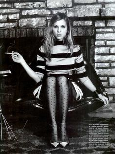 striped dress, dot tights, adorable.                                                                                  (Maybe lose the cigarette...)