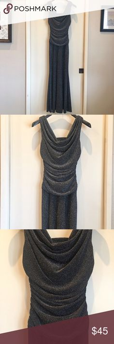"Full Length Black and Silver Metallic Gown Worn once to a Christmas party. Bust to waist is lined. Silver on black Metallic. The outside fabric looks like a high end ""screen"" metal look. Inside fabric silky soft. Very stretchy fabric. Hangs straight but base of hem spins so twirl around on the dance floor or just when you make your entrance! 🤣 Rouching all around bust and waist is SO flattering! Instant slimmer👌🏼 Red lips and I'll post the heels I wore with it. Black tie, prom, wedding…"