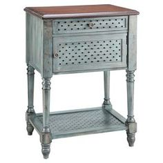 """One-drawer weathered wood end table with center cabinet and open bottom shelf.  Product: End tableConstruction Material: WoodColor: Aged blueFeatures:Country cottage styleTurned legsOne door Dimensions: 31.5"""" H x 22"""" W x 15.75"""" D"""