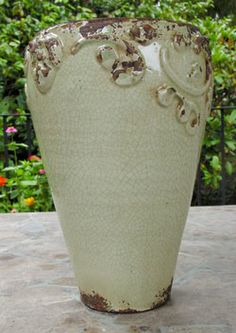"Our Rustic Cherub Italian ceramic collection is unique and beautiful. This Italian Ceramic vase makes a dramatic statement filled with flowers as a centerpiece or in your kitchen window. For decorative use, hand made in a small family-run studio in Tuscany, a region where quality Italian pottery has been created for hundreds of years.  Size: 8"" tall, 4"" diameter"