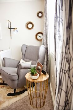 neutral nursery. masculine, nursery for boy. ikea crib, ikea chair, gray mist benjamin moore paint, urban outfitters wall tapestry as curtains, alpaca rug, leather pouf, wall sconce, target side table. autumn clemons interior design. design dump