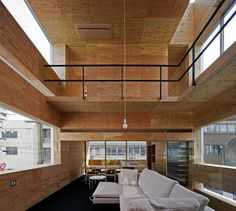 UID Architects // Machi Building // plywood interior mixed with concrete facade