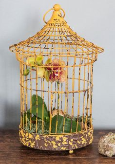 Here Comes the Sunroom Decorative Birdcage. Hang this antiqued birdcage in your solarium and let your imagination soar. #yellowNaN
