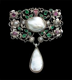 ARTHUR GASKIN 1862-1928 & GEORGIE GASKIN 1866-1934. Arts & Crafts Brooch: Silver, Pink Tourmaline, Emerald Paste, and Pearl. H: 6 cm (2.36 in); W: 4.9 cm (1.93 in). British, c.1907. (Ref: 2970)