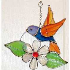 stained glass hummingbird and flower Stained Glass Ornaments, Stained Glass Suncatchers, Stained Glass Flowers, Stained Glass Panels, Stained Glass Projects, Stained Glass Patterns, Stained Glass Art, Mosaic Glass, Glass Wind Chimes