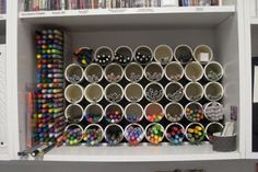 turn the inside of one shelf of a bookcase into a perfect pencil and marker storage space in your craft room Just cut some pvc tubing, sand and stack.