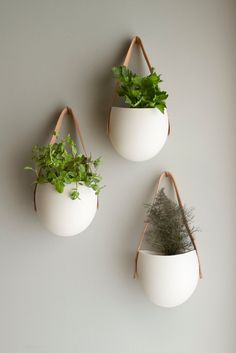 Set of 3 Medium porcelain and leather hanging containers. $130.00, via Etsy.