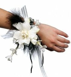 Feathers and bling accent this wrist corsage.  Available with gardenia, or substitute an orchid of any color, $40
