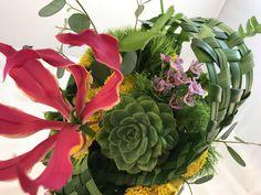 Bouquet. Modern. Sculptural. Woven grass mat, glorious lily, succulent, sweet accents.
