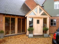 Enhance the beauty and security of your property with our beautiful interior and exterior doors. Our doors are reliable, durable and built to last. Speak to our friendly team at Trustwood Joinery Manufacturers Ltd in Leicester today. Porch Uk, Cottage Porch, Home Porch, House With Porch, House Front, Stone Porches, Brick Porch, Bungalow Extensions, House Extensions