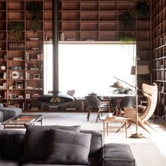 This luxurious apartment in São Paulo by local office Studio MK27 is defined by its double-height shelving, built in dark wood to complement original furniture pieces by designers including Hugo França and Gio Ponti.