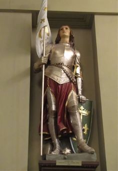 "Joan of Arc, (1412 – 30 May 1431), nicknamed ""The Maid of Orléans"" (French: La Pucelle d'Orléans), is a folk heroine of France and a Roman Catholic saint. She was born to a peasant family in north-east France. Claiming divine guidance, she led the French army to several important victories during the Hundred Years' War, which paved the way for the coronation of Charles VII of France. Pretty sure this is the statue in the St. Louis Cathedral-New Orleans, LA"