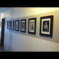 Pinner says:  My gallery hall w horizontal painted stripe     I like how the stripe focuses the eye on the photos.