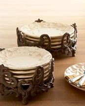 "Dinnerware Holders    Ornate cast-aluminum dinnerware stands add glamour to the buffet table while keeping the dinner and salad plates protected and organized. Dinner plate holder is 12""Dia. x 5.75""T. Salad plate holder is 10""Dia. x 5.5""T. By GG Collection."