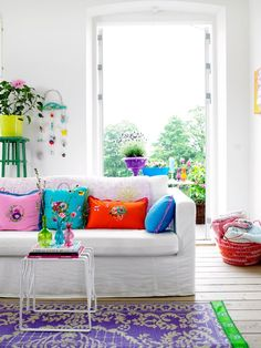 Brighten up a neutral couch with colorful pillows.