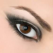 it across your lids and blend well up into creases. Extend the eyeshadow slightly past your outer corners to create the illusion of long, almond eyes. If you make any mistakes, just use a cotton swap dipped in makeup remover to erase the flub.    4. Pile on the mascara. Apply two to three coats black volumizing and lengthening mascara. Use a lash comb if needed to break up mascara clumps and get perfectly fanned out lashes.