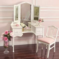 Many of my vintage obsessions are vanities, and this one would look amazing in a shabby chic vintage room. :)