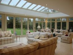 Interior of a hardwood orangery with a bespoke roof lantern
