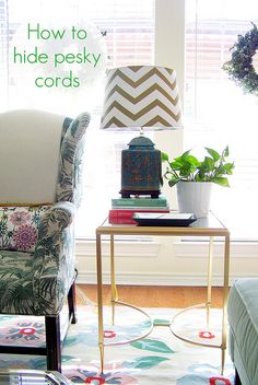 10 Stylish Ways to Hide Unsightly Cords In Your Home Need to plug in a lamp, but the plug is halfway across the room? Use tiny adhesive hooks to attach lamp cords to the back of your furniture, and they'll be hidden in plain view. Hide Electrical Cords, Hide Wires, Lamp Cord, Living Spaces, Living Room, Back To Nature, Home Hacks, Interiores Design, Home Organization