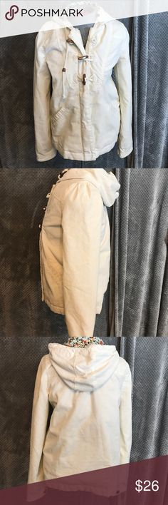 """Roxy corduroy lined coat. Winter white Adorable corduroy coat. Floral lining. Some quilting inside but not too Heaney. Zips and has wooden toggles. Hooded. Bust 19"""". Length 22"""" Roxy Jackets & Coats Utility Jackets"""