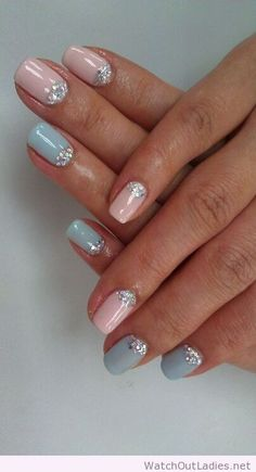 Light pink and blue nail polishes...