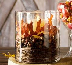 Candle in glass container with grape vine, acorns and leaves. Love this look!