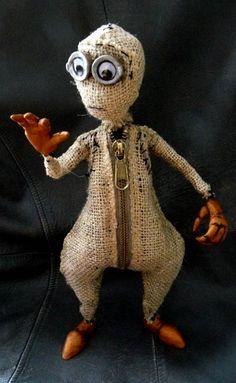 By Jill Lorraine Turpin. There's a tutorial for this little guy if you follow the link. ~ This little guy reminds me of the Minions from the movie: Despicable Me :)