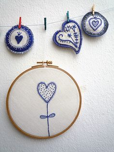 blue and white embroidery. I like how much this looks like delft.