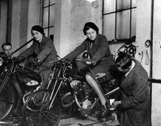 Workers measuring the positions of footrests and controls on partially finished motorcycles, 1933.