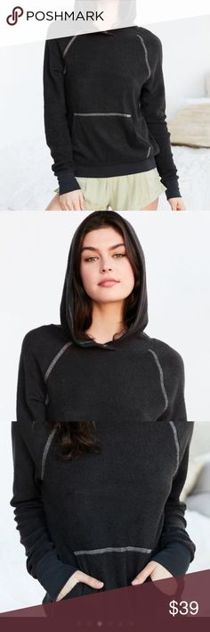 💕NWT Black Soft Hoodie by Urban Outfitters Insanely soft hoodie with shrunken relaxed slim fit with kangaroo pocket and distressed cuffs. Super Comfy. Urban Outfitters Tops Sweatshirts & Hoodies