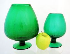 Both Pilgrim crackle glass vases are in excellent condition. Beautiful with flowers, awesome with foliage. You can set a plant pot inside the opening to balance on the rim. Looks great with ferns. Or use as an eye-catching tip jar or candle holder
