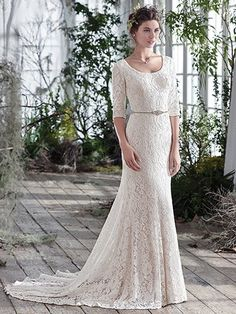Maggie Sottero - FAIRCHILD, Feminine yet simply elegant, this unembellished lace fit and flare wedding dress over Inessa jersey, with three-quarter sleeves and scoop neckline, puts emphasis on refined lightness. Finished with covered buttons over zipper closure. Detachable beaded belt sold separately.