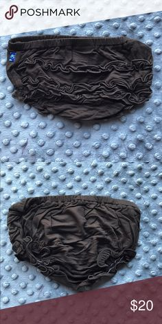 Kicky (Kickee) Pants Bark Brown Ruffle Bloomers New with original tags. Highly sought after Kicky Pants brand. Ruffle bloomers/diaper/underwear cover. Ruffles are on the booty and are absolutely adorable underneath a dress at any age! 95% bamboo viscose. 5% Lycra. Hand wash or gentle cycle. These are older (but still brand new) when the brand was still spelled Kicky Pants. They've since changed the spelling to Kickee Pants. Same brand! 🍦🍼 Reasonable offers welcome. No trades. Note: 15% off…