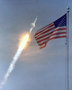 A vapor cone surrounds Apollo 11 as it breaks the sound barrier en route to the Moon, July 16, 1969