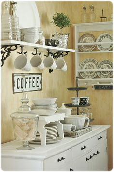 Kitchen and Dining Storage - using a dresser as a sideboard and shelves, all painted white - via Strandvik villa: Thursday Theme: Kitchen / Tableware