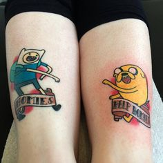 Finn the Human and Jake the Dog matching tattoos.