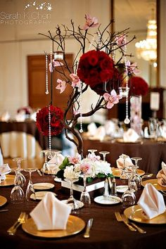 Manzanita Centerpiece with hanging floral balls and crystals and pink flowers with cream