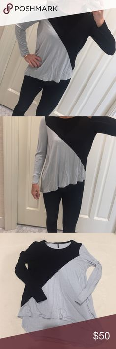 BCBG long sleeve top Super soft loose fitting long sleeve top by BCBG. Sky blue and black color blocking. Hemline falls diagonally across the hips. Excellent condition with no snags or pilling BCBG Tops Tees - Long Sleeve