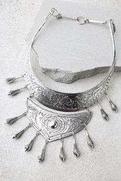 """Good vibes only in the Natalie B Protector Silver Statement Necklace! An engraved, antiqued silver collar necklace with dangling charms. Necklace measures 14"""" around."""