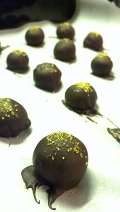 Dark Chocolate Grand Marnier Truffles. Chop up 2 bars 70% dark choc (I used Green & Black's) & put in bowl. Heat 1/4 cup heavy cream until just simmering, add to chocolate, along with 1 oz Grand Marnier liqueur, and stir until chocolate is melted & smooth. Chill overnight. Spoon out & hand roll into balls. Chill those while melting/tempering 2 bars dark choc for coating. Dip & garnish. Set 1 hr. Enjoy!