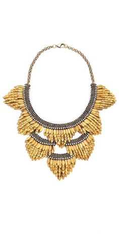 Deepa Gurnani Deepa Gurnani Fringed Layered Necklace FREE SHIPPING at shopbop.com. A striking bib necklace from Deep Gurnani, crafted in lavish layers of antiqued petals interrupted by curved crystal accents. This piece is finished with suede backing and a lobster-claw clasp. Handcrafted in India. MEASUREMENTS Length: 14in / 35.5cm Drop: 10in / 25.5cm - Gold
