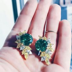 @ashleylikesgems taking a closer look at our stunning #emerald  and yellow #diamond statement earrings made with @gemfields emeralds.
