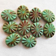 Ten 14 x 10mm rustic oval opaque turquoise green picasso, table cut. carved, Czech glass beads, carved front and back sunburst beads C2901