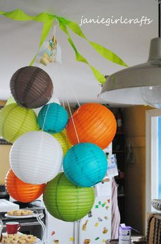 Paper Lanterns  on Etsy. The shop lets you pick ten lanterns of your color choice.